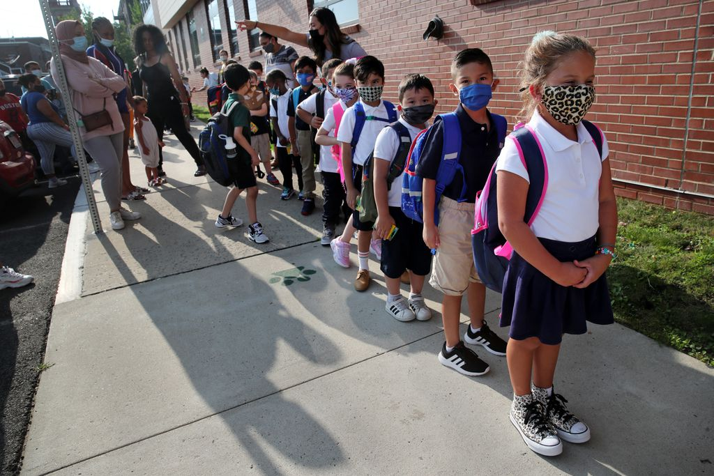 Arianna Licona, 6, led a class of first graders into the Hill School for Revere's first day of classes on Wednesday. For the first time since early March 2020, all 11 Revere Public Schools opened at full capacity for the 2021 school year.CRAIG F. WALKER/GLOBE STAFF/THE BOSTON GLOBE