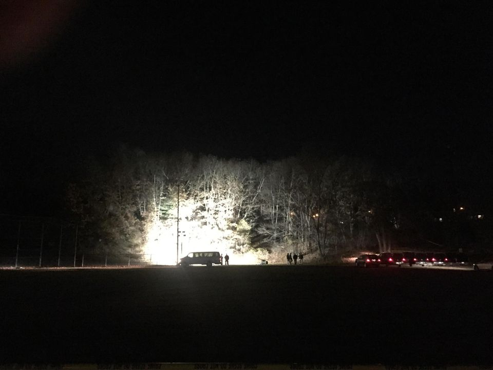 Investigators illuminated part of a hill located at the edge of Frey Playground Thursday night.