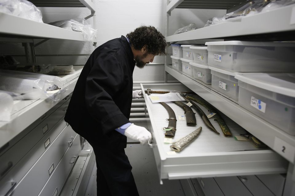 Curator Jeffrey Forgeng pulled open a drawer at the Higgins Armory Museum in Worcester in December 2013.