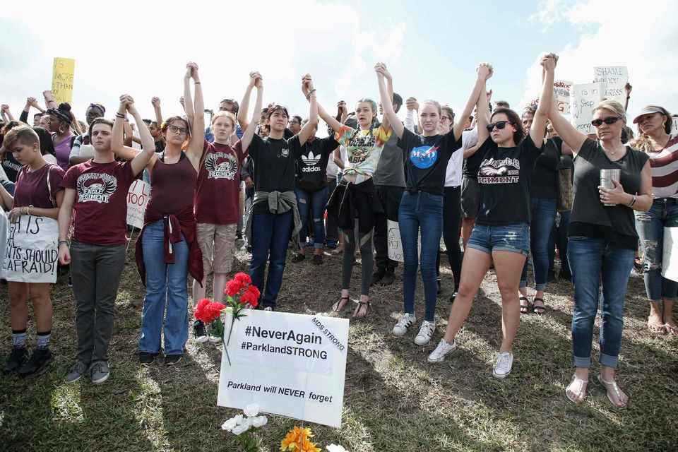 Students of area high schools rallied at Marjory Stoneman Douglas High School after participating in a county-wide school walkout in Parkland, Fla., on Feb. 21, 2018.