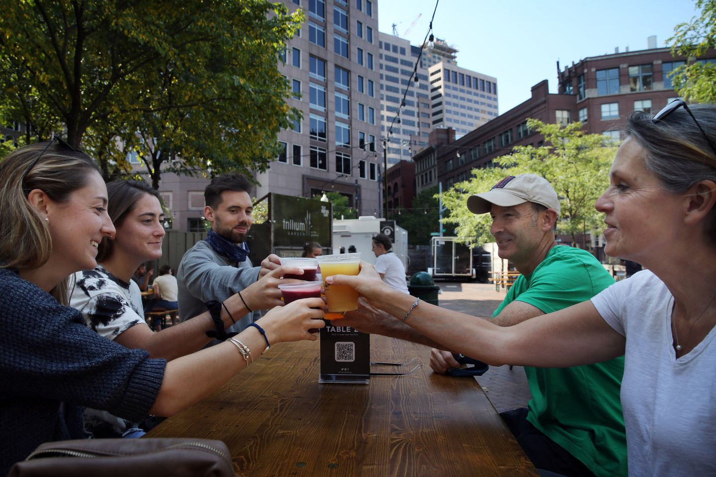 Sarah Richardson (left), her sister, Julia DePillo, and husband, Justin Richardson, had a beer with the sisters' parents, Stephen and Patricia DePillo at Trillium Garden.