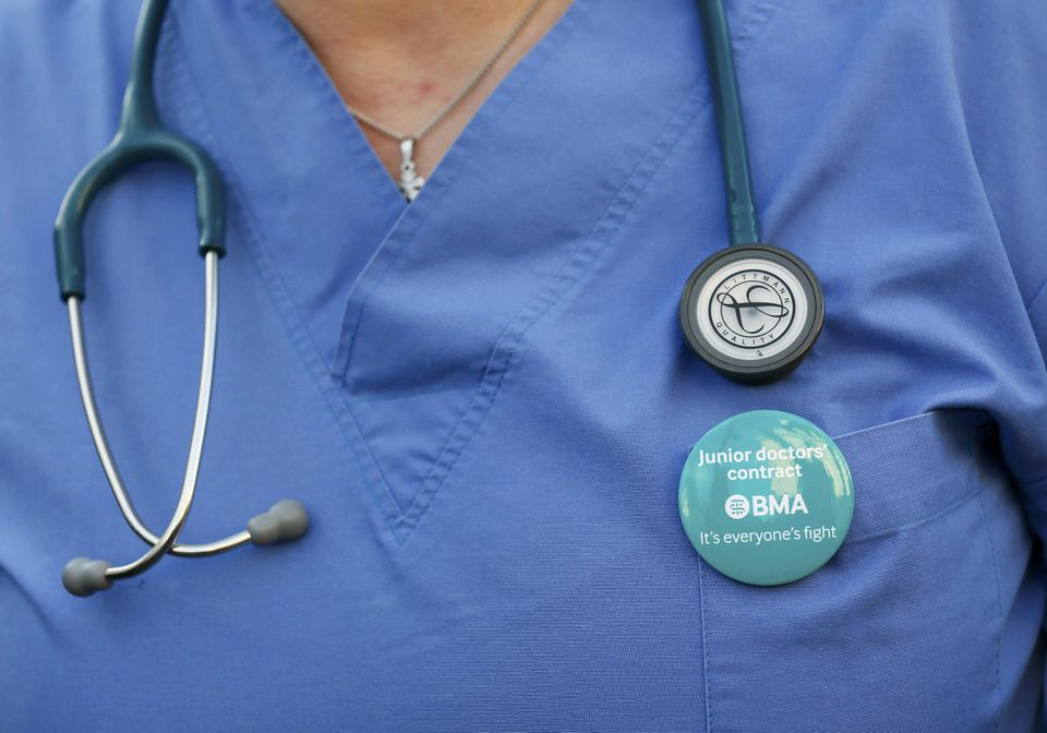 A doctor wore her stethoscope during a strike in central London on Jan. 12, 2016. English doctors staged their first strike in 40 years over government plans to reform pay and working conditions.