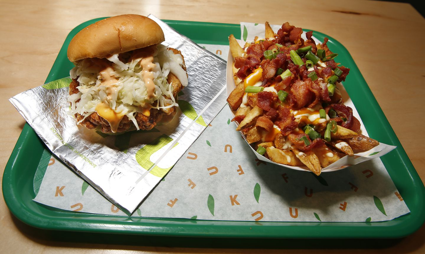 The Loaded Fries and Knockout Sandwich at Fuku.