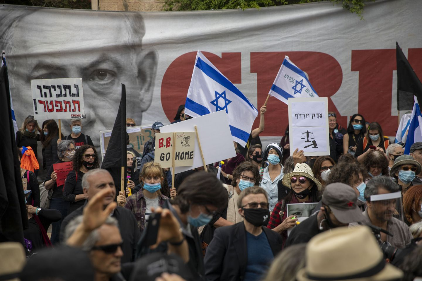 Protesters demonstrating against Israel's Prime Minister Benjamin Netanyahu held flags and banners outside his residence in Jerusalem last month.