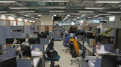 Monitors are left on desks after police confiscated the computers as evidence in the newsroom at Apple Daily headquarters in Hong Kong, Thursday, June 17, 2021.