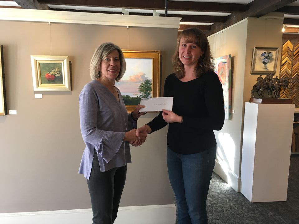 Donna Keaney, left, of the Special Needs Athletic Partnership, received a check from Kate Sotolova of South Street Gallery. The funds are raised through the gallery's art appraisal days.