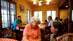 Alice Erickson (left) chatted with Diana O'Hara of Framingham inside the dining hall at Sandy Island Family Camp on Lake Winnipesaukee in 2013.