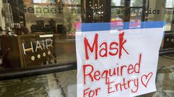 A sign on the door of a hair salon informing patrons that masks are required to be in the business in Kansas City, Mo. St. Louis County's top elected official insisted Wednesday, July 28 that a mask mandate remained in place even though the county commission voted to overturn it. Across the state, meanwhile, Kansas City issued its own order in an effort to stem a rise in COVID-19 cases that is straining hospitals, leading to an immediate threat of a lawsuit.