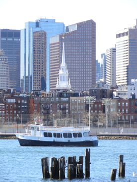 In Boston Harbor, the Charlestown MBTA ferry motors past the landmark Old North Church.