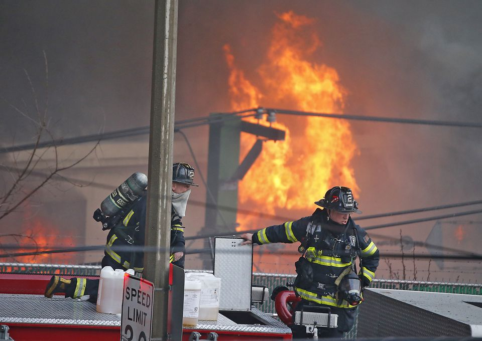 Massive flames sprung from the New England Casket Co. building on Friday evening.