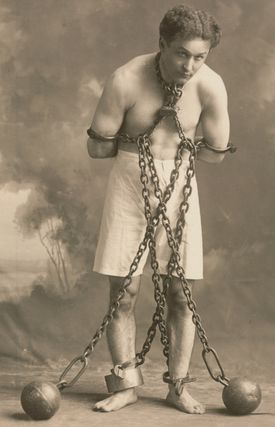 Houghton Library Houdini in chains, c. 1905.