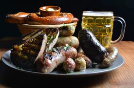 A Wurst Platter served with sauerkraut and potatoes with a Giant Haus Bretzel with roasted appel mustard and Weihenstephaner Dunkel Hefe-Weissbier at Bronwyn in Union Square.. Josh Reynolds for The Boston Globe (Lifestyle, First) 25dining