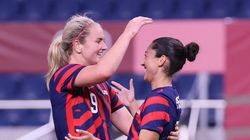 Christen Press (right) celebrates her goal with Lindsey Horan during the Americans' 6-1 victory over New Zealand on Saturday.