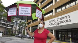 Around 50 people gathered outside the Duval County School Board building in Jacksonville, Fla., in support of having mandatory masking of teachers and students.