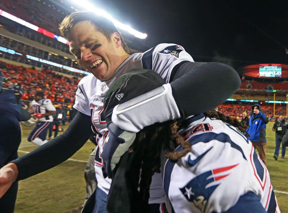 Tom Brady hugs Stephon Gilmore after the win.