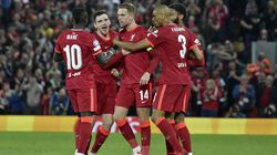Liverpool captain Jordan Henderson (center) celebrates with his teammates after scoring his side's third goal during at 3-2 victory over AC Milan in a Champions League Group B match.