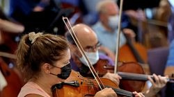 Abby Cross played her viola during a recent rehearsal. Landmarks Orchestra is returning to the Hatch Shell with a six-week season of free concerts.