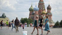Girls pose for a selfie on Red Square next to St. Basil's cathedral in Moscow on July 21.