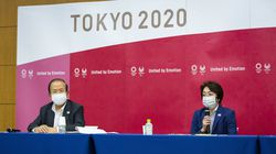 Tokyo 2020 CEO Toshiro Muto, left, and President Seiko Hashimoto attend the news conference after receiving a report from a group of infectious disease experts on Friday, June 18, 2021, in Tokyo.
