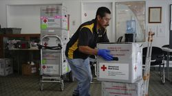 A courier driver picks up ice-boxes containing human blood at the American Red Cross office in Santa Monica, Calif., in March.
