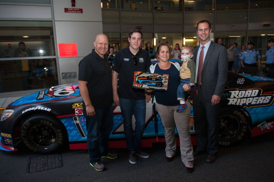 From left: Toy State president Andy Friess, NASCAR driver Alex Bowman, Boston Children's Hospital patient Jackson Waleski and his mother Kelley, and Boston Children's Hospital Trust associate director Charles Savicki.