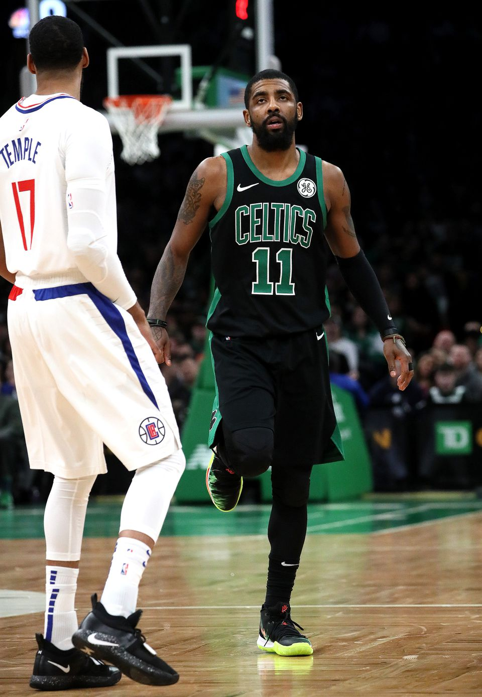 Kyrie Irving flexes his leg after he appeared to sprain his right knee in the second quarter. Irving left the game and did not return.