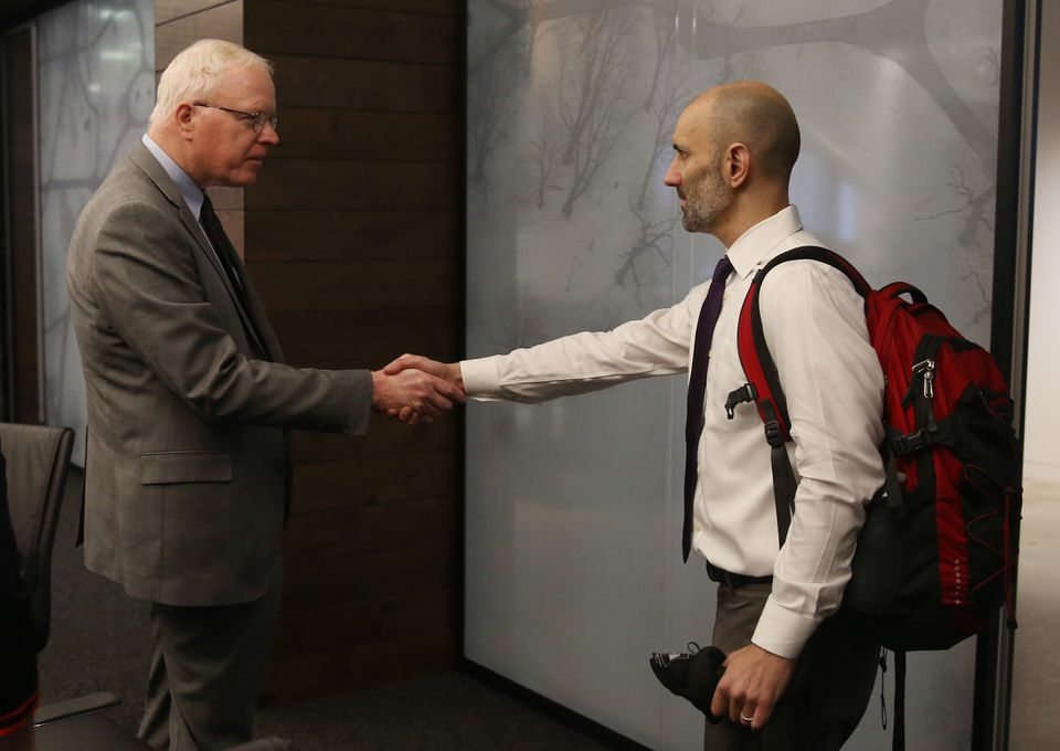 Patrick Wardell, chief executive officer (left) shook hands with Pete DeMarco at the start of a meeting.