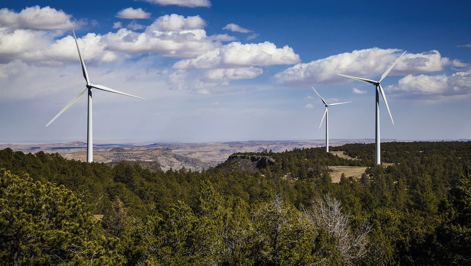 This image provided by New Mexico power company PNM shows some of the more than five dozen giant turbines erected on a remote mesa in the state.