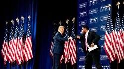President Donald Trump fist bumps Herschel Walker, a former NFL player, at an event about Black economic empowerment in Atlanta, Sept. 25, 2020.