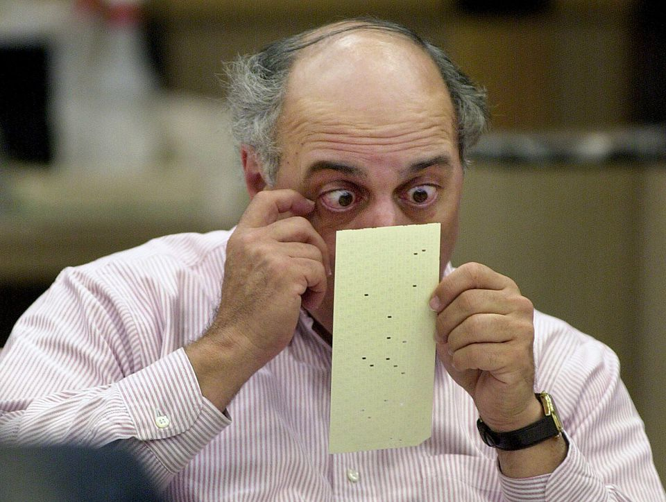 Broward County canvassing board member Judge Robert Rosenberg looked over a questionable ballot at the Broward County Courthouse in Ft. Lauderdale in 2000.