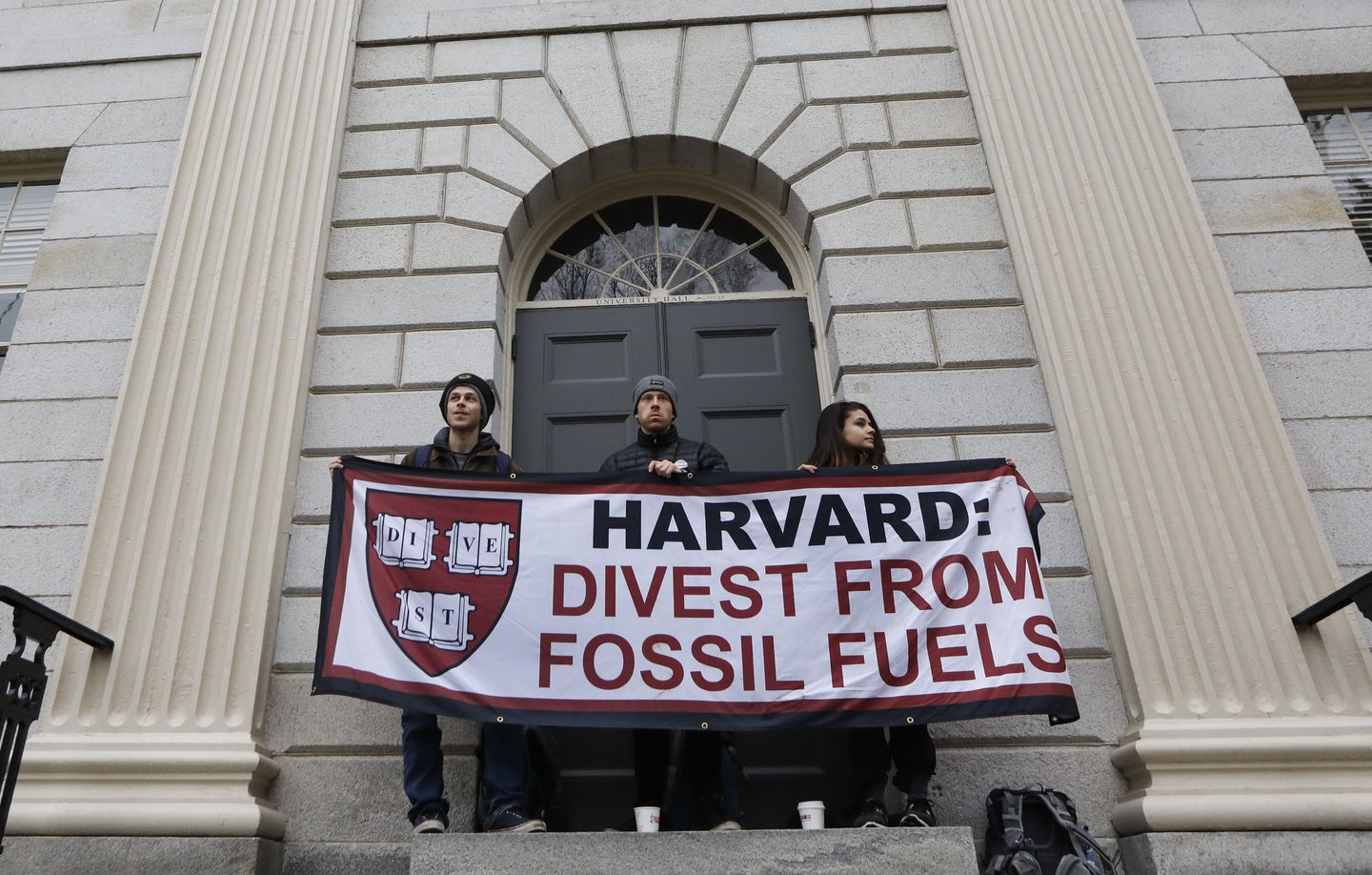 Students demanding Harvard University divest from fossil fuels block the entrance to University Hall in 2017.