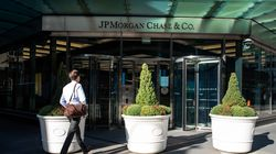 A person walk towards JPMorgan Chase & Co. headquarters in New York.