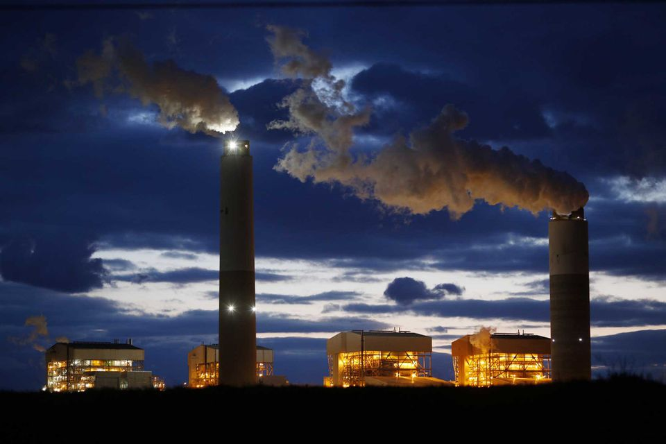 Emissions rise from the coal-fired Santee Cooper Cross Generating Station power plant in Pineville, S.C., in March.