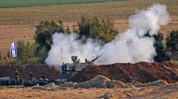 Israeli soldiers fired a self-propelled howitzer toward the Gaza Strip on Thursday as fighting intensified