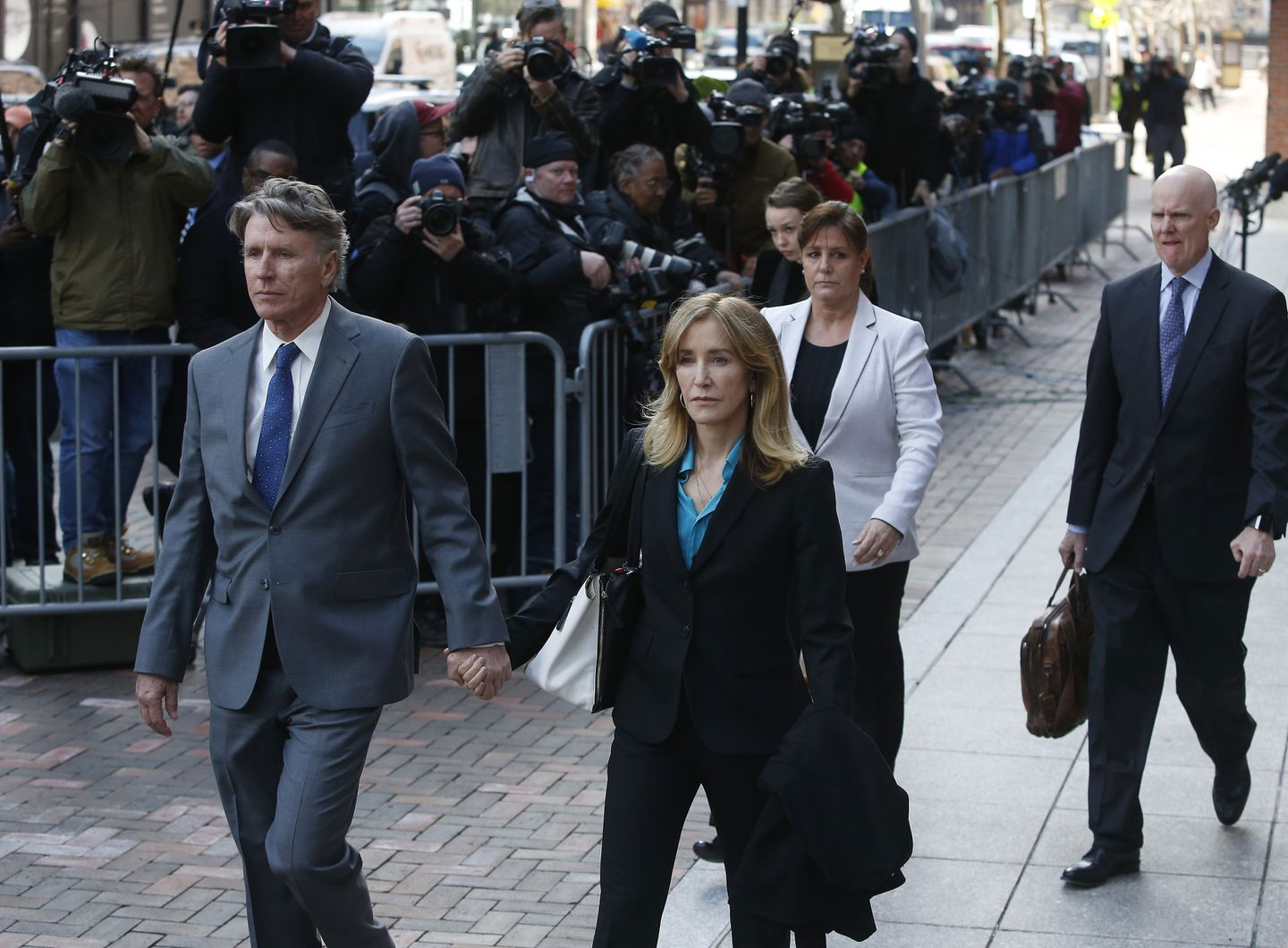 Actress Felicity Huffman left Federal Court in Boston in April