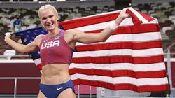 Katie Nageotte celebrates with the United States flag after winning gold in the women's pole vault.