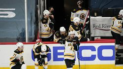 Some dejected Bruins wait to see if the Capitals' Nic Dowd's overtime goal would stand. It did, giving Washington the Game 1 victory Saturday night.