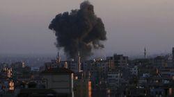 Smoke rises following Israeli airstrikes in Gaza City on Thursday.