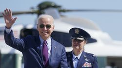 President Joe Biden waves as he walks to board Air Force One for a trip to Michigan to visit a Ford plant, Tuesday.