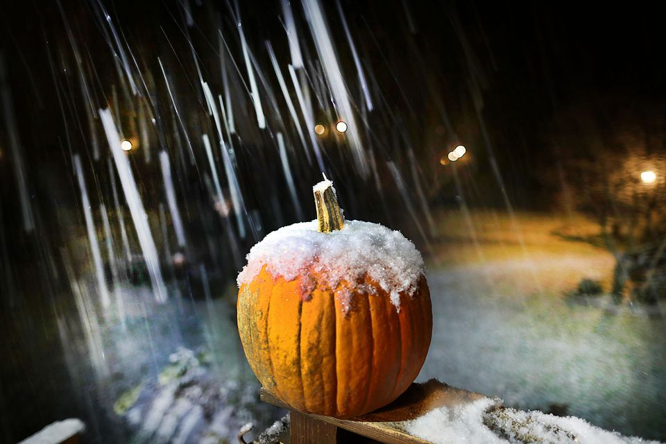 The first snowfall of the year covered a pumpkin on a railing in a Pembroke front yard on Thursday evening.
