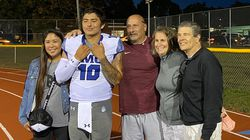 IMG Academy quarterback A.J. Duffy, flanked by his parents, Alma and Peter, reunited with family at Berte Field in Springfield Saturday night.