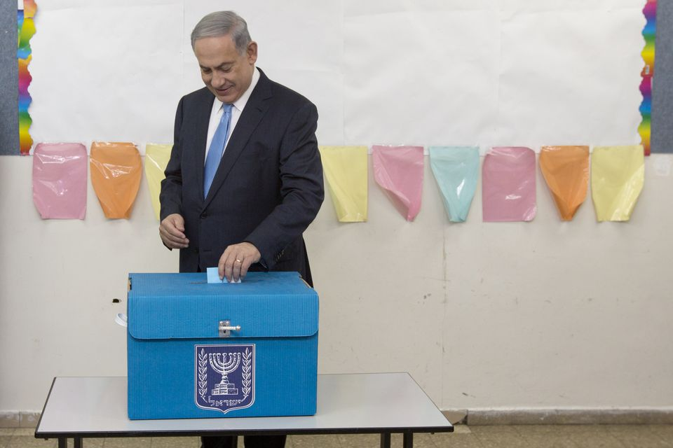 Israeli Prime Minister Benjamin Netanyahu, pictured casting his vote during Tuesday's parliamentary elections, led his party to a stunning victory.