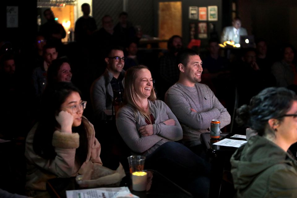 """Audience members react to a joke at """"Comedy Hell."""""""