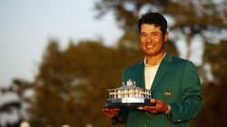 Hideki Matsuyama of Japan poses with the Masters Trophy during the Green Jacket Ceremony after winning the Masters at Augusta National Golf Club on April 11, 2021 in Augusta, Georgia.