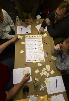 Boston's Game Makers Guild troubleshoots games in development by playing them and looking for flaws. Pictured, the guild playing Zarathustra.