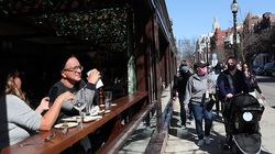 Diners and strollers on Newbury Street enjoy the spring weather.