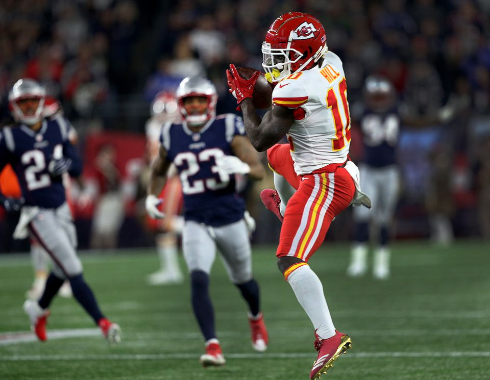 Tyreek Hill (10) leaps to make a long touchdown reception that tied the game at 40-40 late in the fourth quarter.