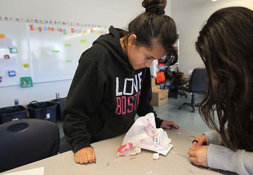 At the Eliot in the North End, eighth-graders make a vehicle out of a cup, paper clips, Life Savers, and plastic bags in their engineering and robotics course.