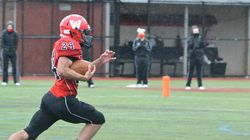 Watertown senior JP Riley had a clear path to the end zone in rain drops for his 57-yard run in the third quarter of the Raiders' 38-14 win over Boston Latin Saturday at Victory Field.