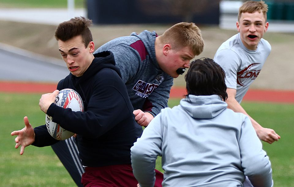 Clay Casaletto cuts upfield during rugby practice.